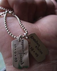 Dog tags.... for reception seat cards (placed around napkins) Dog Tags