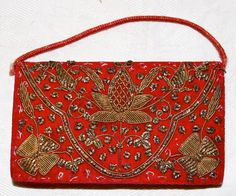 Red Velvet and Gold Thread Indian Coin Purse. $29.00, via Patriciaville.etsy.com.