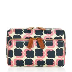 Orla Kiely: Wash bag featuring Floating Flower print and brown lining. The perfect way to transport toiletries, and it makes a great gift!