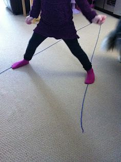 "With just a string and the floor, your child can ""practice gross motor skills"" which they just see as part of playtime."