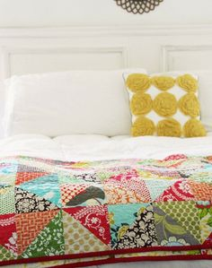 "This is why I have white sheets: to make a flowered pillow ""pop!"" and make ""homey"" with a great quilt."