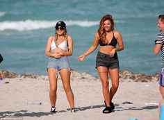 Bronzed beauty: Jesy showed off her enviable figure in a black bikini top and matching cut...