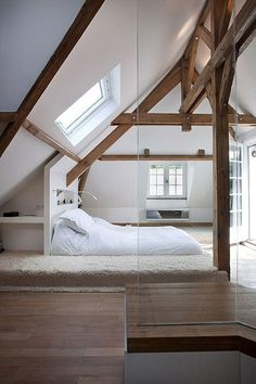 Photo by Olivier Chabaud Architecte – Discover rustic attic bedroom design inspiration. Stunning modern attic bedroom with wood floors and wood beams throughout. Attic Bedrooms, Home Bedroom, Modern Bedroom, Master Bedroom, Modern Beds, Bedroom Decor, Bedroom Ideas, Bedroom With Loft, Bedroom Wall