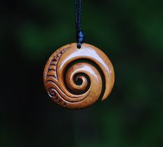 Bone  Koru  Handcarved & naturally stained by JackieTump on Etsy,