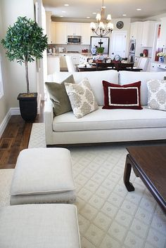 I love this layout, with a smallish secondary living room space so near to the kitchen.  Great couch and pillows, too!