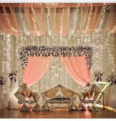 Lovely peach and gold wedding stage with flowers, lights Wedding Stage Design, Wedding Stage Decorations, Wedding Themes, Wedding Designs, Desi Wedding Decor, Church Decorations, Wedding Mandap, Wedding Venues, Wedding Halls