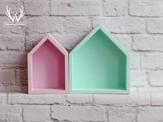 Trendy set of rose and mint house-shaped shelves.