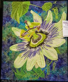 Image from http://3.bp.blogspot.com/-KL2QCl1dUC0/U16lieQ8ONI/AAAAAAAAXZo/cs5EMQYfdmQ/s1600/Passion+Flower+by+Pam+George,+2014+AQS,+photo+by+Quilt+Inspiration.JPG.