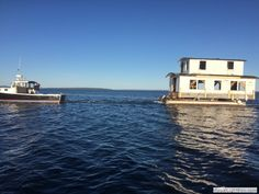"2015-09-28 Houseboat Sails Past Bayside, photographed Saturday by Jon Linn. ""This house came sailing past Bayside on its way from Dark Harbor Boat Yard to Belfast. It was the summer home of Willis Rossiter, the head carpenter at the Boat Yard for several years, until he passed away about 30 years ago. It is headed in for a rehab."""