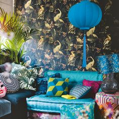 Colourful cushions go a long way towards personalising a temporary space such as a rented room or your student digs. Be sure to bring in funky patterns and vibrant hues if you want to make a statement, as in this modern living room. Image: Livingetc