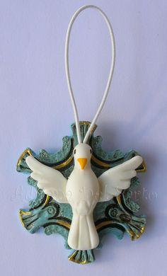 http://www.elo7.com.br/lembrancinha-pendente-divino-azul/dp/263733