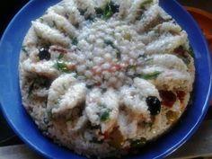 Insalata di riso con salmone e rucola