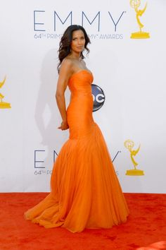 Padma Lakshmi in Monique Lhuillier #Emmys2012 - I WISH I could pull of this brilliant orange hue, but it looks amazing on her skin, and her bod is rockin.
