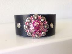 Crystal pink ribbon cuff on black leather cuff