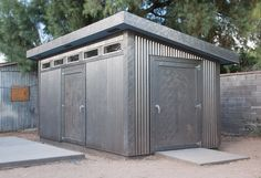 Metal Shed Doors With Corrugated Metal Siding Transom Windows And Secure Doors This Storage Shed Is Built To Last Metal Shed Doors Sticking Metal Storage Sheds, Metal Shed, Wood Shed, Storage Shed Plans, Modern Shed, Modern Garage, Shed Makeover, Metal Siding, Backyard Sheds