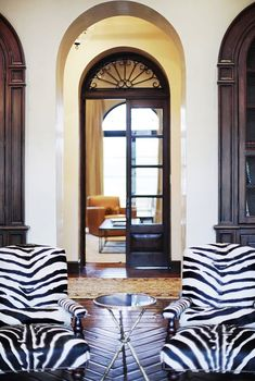 Tall french doors, gorgeous fanlight and could I interest you in a spot of zebra my dear?