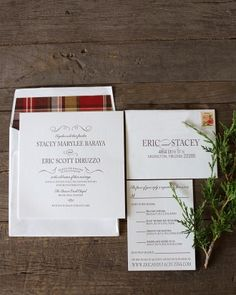 Plaid-lined envelopes accompanied letterpressed invitations to create an elegant, yet approachable mountain wedding theme.