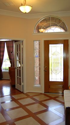 Entry features beautiful combined hardwood and tile floor.  #Kitchen #Floors #House