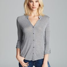Joie Shey B Striped Knit Button Down Top A lovely and soft, fine knit striped button-down top from Soft Joie, detailed with a fold-over collar. Button-tabs gather the cuffs, converting the sleeves from 3/4 to elbow length. 100% rayon, runs small - perfect for XS-M! Joie Tops Button Down Shirts