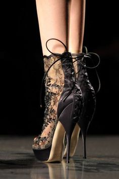 Black lace heels by Alexander Wang