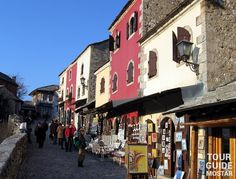 Photo of the souvenirs, shops, handcrafts and paintings on the streets of Old Town in Mostar. #mostar #TGM #TourGuideMostar #souvenirs #europe #handcrafts #architecture #paintings #citylife #tradition #herzegovina #luxurytravel