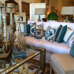 Like the assortment of pillows--INSPIRED DESIGN: Retailer Spotlight: Eros Clothing and Home