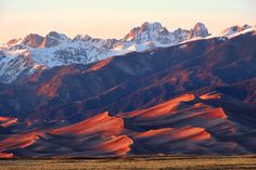 The Great Sand Dunes (National Park, Colorado) at sunset.  The dunes have been formed over thousands of years, as sand deposited by mountain streams and playa lakes on the San Luis Valley floor is carried in the form of small dunes by predominant southwest winds toward a low curve in the Sangre de Cristo Mountains.