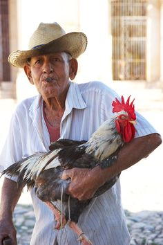 I saw a man with a chicken like this in Cuba, in Puerto Rico, in Panama, In Brazil & in Brooklyn...