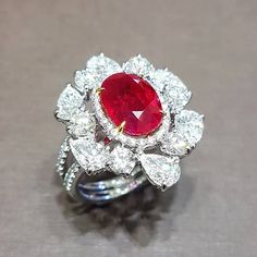 The Ruby Ring from The Incredibles by PrimaGems is a stunning oval shape Burmese ruby center stone surrounded by pear shaped diamonds. Red Jewelry, High Jewelry, Diamond Jewelry, Women Jewelry, Jewellery, Custom Jewelry Design, Pear Shaped Diamond, Diamond Are A Girls Best Friend, Jewelry Branding
