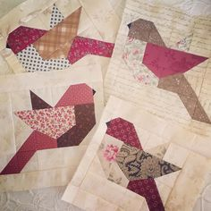 "I love these bird blocks so much but wow they mess with my head. Tho maybe it's the heat. We'll go with that excuse since I have 26 more to make. It's the ""Feathers"" pattern by @thepatternbasket in case you need to make a flock of your own. #quilting #birds #usingupmystash"
