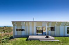 Completed in 2017 in Te Horo, New Zealand. Images by Paul McCredie. Te Horo Bach: Is a small holiday house for a family of four. A retreat, located an hours drive north of Wellington on wild and beautiful. Built In Sofa, Window Glazing, Sliding Windows, Open Plan Living, House And Home Magazine, Sustainable Design, Architecture, Cladding, Decoration