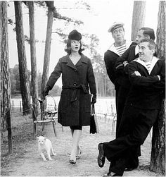 Audrey Hepburn and her cat take a walk. And other classic movie stars w/ their pets.