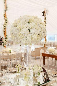 Glamorous white floral wedding reception centerpiece; Featured Photographer: Colin Miller