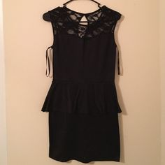 Black key hole dress Black key hole peplum dress size medium Deb Dresses
