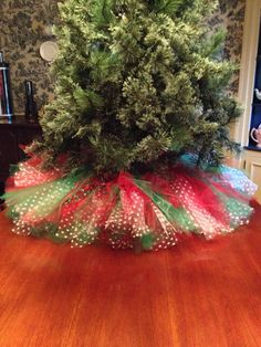 Do white tulle, with lights underneath... Red Christmas Tree Skirt Tulle by Bowsbaublesandbeads on Etsy (Wonder if the Cat would still be able to play under the tree with something like this....hmmm)