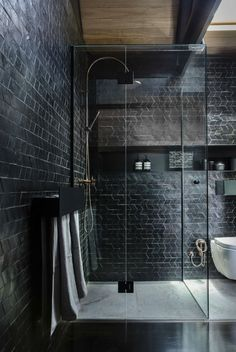 Moody modern bathroom with black tiles and fittings Black Tile Bathrooms, Bathroom Tile Designs, Luxury Bathrooms, Modern Bathroom, Toilet Tiles Design, Rustic Bathrooms, Master Bathrooms, Dream Bathrooms, Dream House Interior