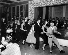 """This just makes me smile: the bunny hop!     Source: westernclippings.com says:  """"Ray Anthony leads a group as they dance to his big hit of """"The Bunny Hop"""" at Ciro's. Behind Anthony is actress Mitzi Gaynor and Hugh O'Brian. Man with the mustache is comedian Jerry Colonna. Marie Windsor watches on the left""""."""