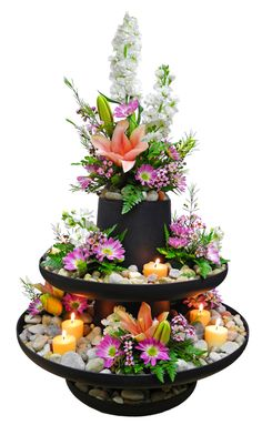 centerpieces. I don't like THIS per say, but something similar. might be cheaper than flowers?