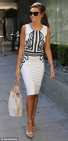 City slicker: The 27-year-old looked stylish in the fitted white pencil dress worn with silver heels