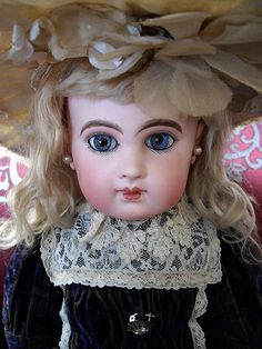 French Bisque Bebe Depose EJ by Emile Jumeau, circa 1885, marked 8 (head) Jumeau Medaille d'Or Paris (body).