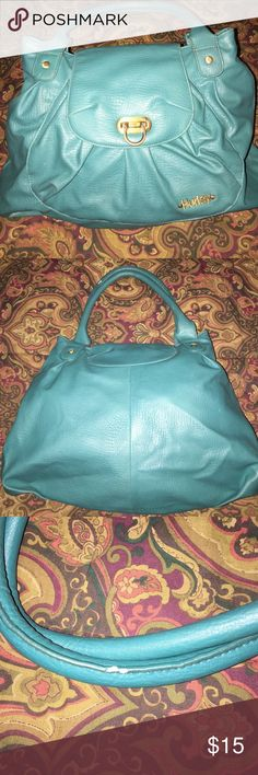 Cute Turquoise Bag By Hurley This bag is so cute a holds A lot! It has one pocket on front exterior and one zippered pocket on interior. There is a small chip on paint on handle that I pictured. Not noticeable when carrying. Otherwise it's in excellent condition. I 💜 the latch closer, 💕💕 Hurley Bags Shoulder Bags