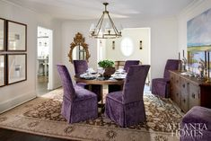 """Mary Kate wanted this house to have a more bohemian and collected look,"" says Woodbery. Dining chairs upholstered in a Pierre Frey velvet and contemporary artwork by Sunny Goode add punch to a scheme that includes a Moattar rug, antique buffet from Bungalow Classic and custom Bradley dining table."