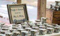 "Mason Jar Wedding Favors: These were inspired by the idea of using mason jars as favors. We used mini wide mouth mason jars, filled them with Hershey hugs and kisses, put a piece of burlap on the lid, a card-stock heart that said ""Thank you"" on top and a twine bow tied around the lid. The sign tied everything together."