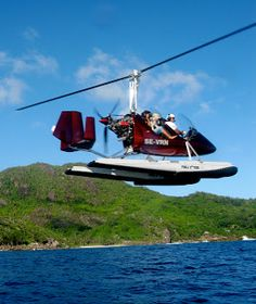 Gyrocopter flying in the Seychelles.