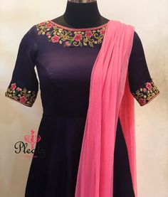 Dark navy blue with a splash of pink from Pleatz Sakura collection . Beautiful dark navy blue color floor length anarkali dress with splash pink net dupatta. Anarkali dress with classy floret lata design hand embroidery gold thread and zardosi work on neck line and sleeves.  10 May 2018