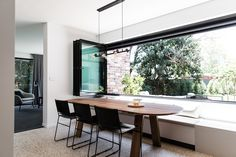 House call: Step inside modern and edgy Australian design home. Dining table with large bifold windows opening out to courtyard. room ideas modern dining room ideas room ideas apartment room ideas on a budget dining rooms Modern Window Seat, Modern Windows, Casual Dining Rooms, Modern Dining Table, Modern Brick House, Dining Room Windows, Loft, Dining Room Inspiration, Dining Room Design