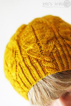 Ravelry: Lete's Fuego Hat. I love the twisted stitch detail.
