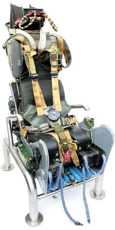 A truly one-of-a-kind chair for military and aviation buffs. This is the Martin Baker ejector seat, originally used in a Buccaneer that flew with the British Royal Navy and the RAF. Aviation Furniture, Aviation Decor, Robin Olds, Flight Simulator Cockpit, Ejection Seat, Cheap Air Tickets, Aircraft Parts, Jet Engine, Men Stuff