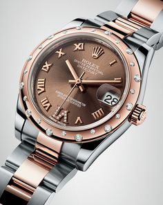 A ladies watch to cherish. The Rolesor version of the Rolex Oyster Perpetual Datejust 31, in steel and 18ct Everose gold, with a domed bezel set with diamonds and chocolate dial.