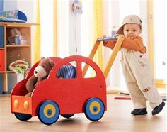 Haba Pushing Car Walker Wagon - Taking Teddy or Dolly for a ride has never been more fun! The Haba Pushing Car Walker Wagon is great for beginning walkers and beyond. Teddy will stay. Wooden Baby Toys, Wood Toys, Toddler Toys, Kids Toys, Matchbox Car Storage, Wooden Truck, Popular Crafts, Baby Footprints, Hot Wheels Cars